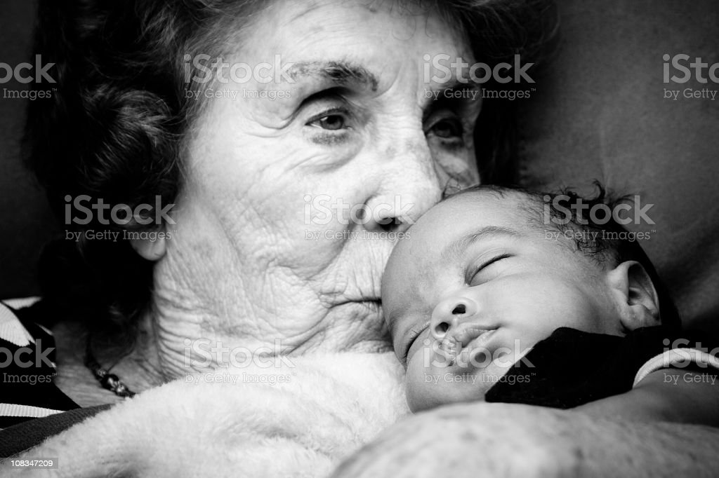 Great Grandma holding a Baby Boy stock photo