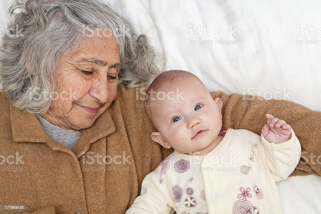 Great Grandma Laying Down With Baby royalty-free stock photo