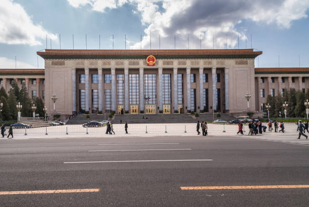 Great Hall of the People with people and car, Beijing. stock photo