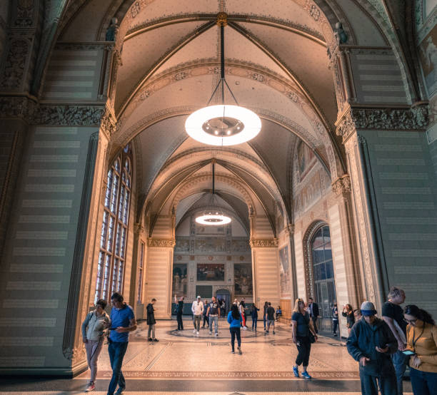 Great Hall of the Rijksmuseum, Amsterdam, Netherlands Amsterdam, North Holland / Netherlands - June 22nd, 2019: Great Hall of the Rijksmuseum with some visitors rijksmuseum stock pictures, royalty-free photos & images