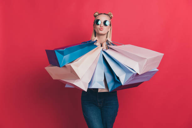 great hot big seasonal sales concept. Photo of nice positive with blow pouted plump lips hipster wearing jeans denim clothes holding different many bags in hands isolated pastel background great hot big seasonal sales concept. Photo of nice positive with blow pouted plump, lips hipster wearing jeans denim clothes holding different many bags in hands isolated pastel background i love shopping stock pictures, royalty-free photos & images