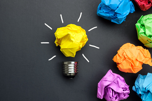 istock Great idea concept with crumpled colorful paper and light bulb 1136171806