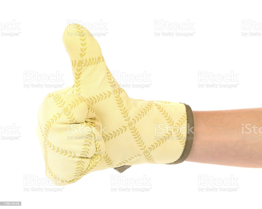 Great. Kitchen glove is put on the hand. royalty-free stock photo