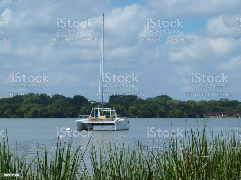 A Great Lakes Class Catamaran Gives Tours on White Rock Lake stock photo