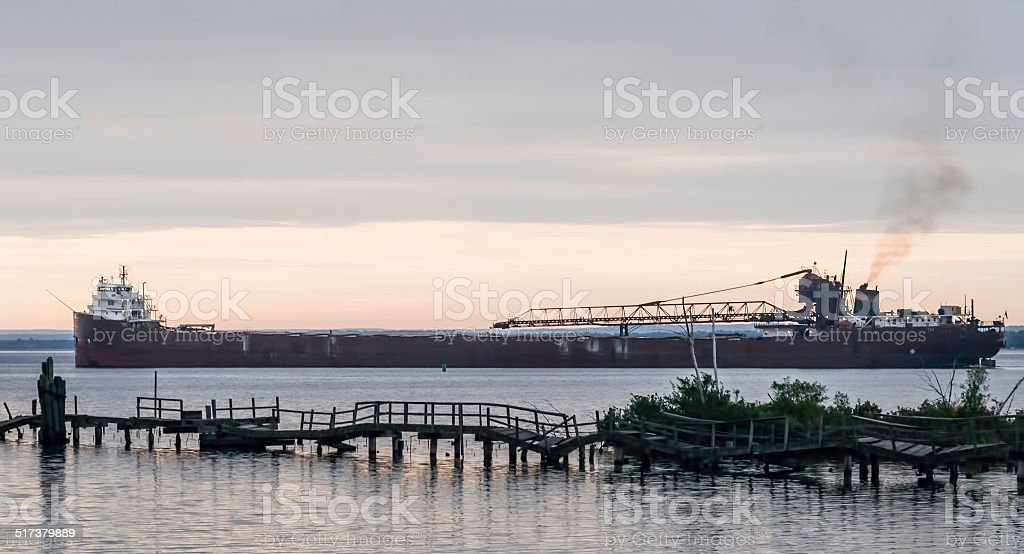 Great Lakes merchant vessel sets out from port stock photo