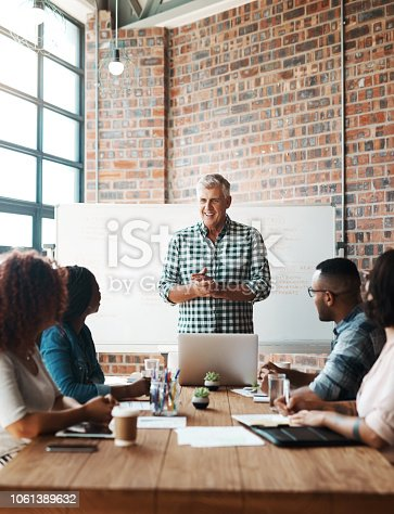 Shot of a businessman giving a presentation in the boardroom