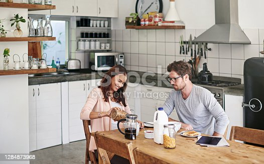 Shot of a young couple having a leisurely breakfast together at home