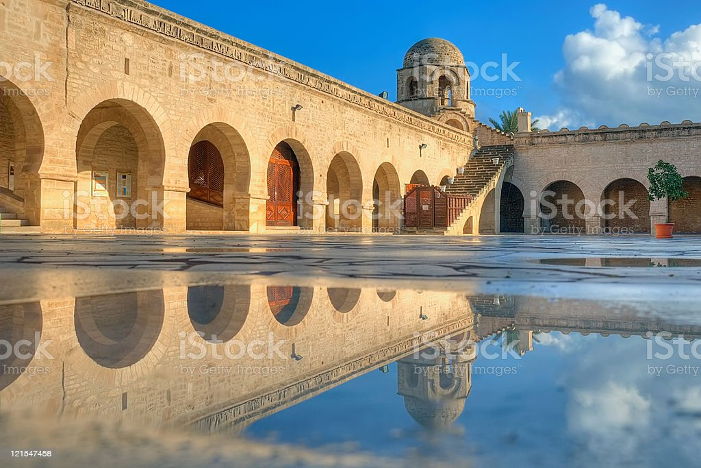 Great Mosque in Sousse and its pool reflection stock photo