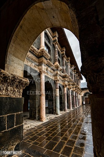 Diyarbakir, Turkey - October 24, 2018: The Great Mosque (ULU MOSQUE - ULU CAMi) of Diyarbakir is the oldest and one of the most significant mosques in Mesopotamia, Turkey. People walking in front of the minaret and They are visiting Ulu Mosque and They are going to praying to mosque.