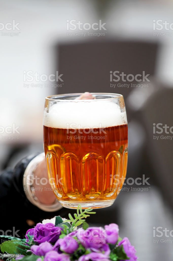 Great mug of beer with foam , garden restaurant royalty-free stock photo