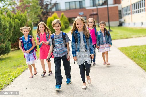 istock Great Portrait Of School Pupil Outside Classroom Carrying Bags 846088100