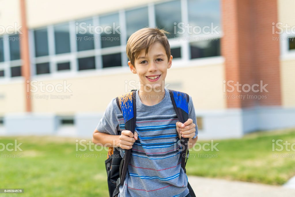 Great Portrait Of School Pupil Outside Classroom Carrying Bags royalty-free stock photo