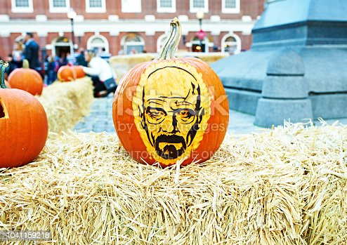 BOSTON, USA - OCTOBER 26: Great Pumpkin Party, halloween festival of creative pumpkins at street. Pumpkin with Walter White/Heisenberg, the character from Breaking Bad show,  October 26 2014 in Boston, USA