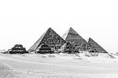 The pyramids of Giza, Cairo, Egypt;  the oldest of the Seven Wonders of the Ancient World, and the only one to remain largely intact. Black and white.