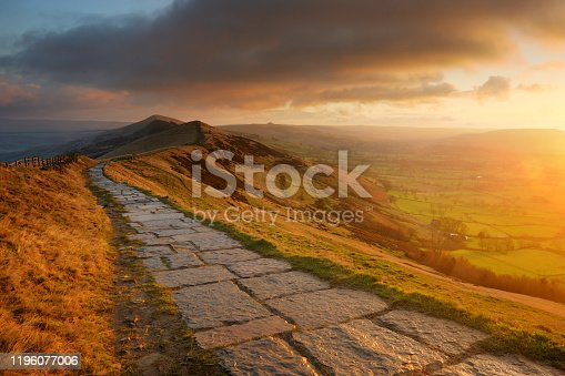 View along The Great Ridge from Mam Tor in the Peak District National Park. Edale Valley on the left and Hope Valley on the right. Taken during early morning sunlight.
