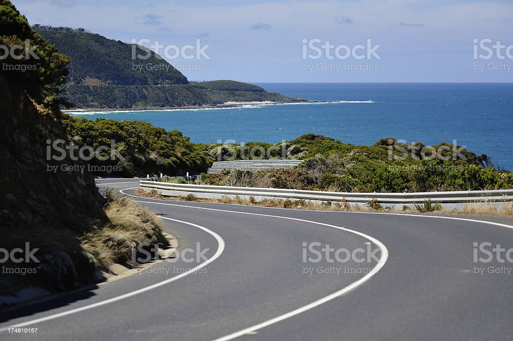 Great road by the ocean on a clear day stock photo