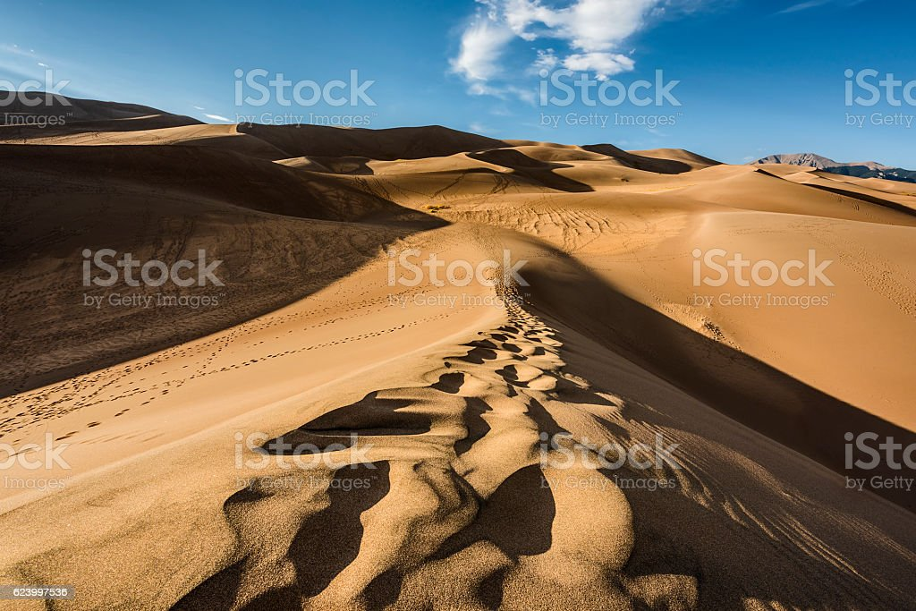 Great Sand Dunes in Colorado with footprints trail path stock photo