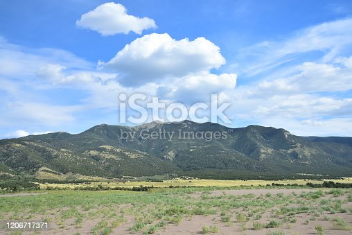 Mountains and desert landscape are part of Great Sand Dunes National Park, Colorado.