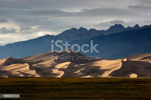 Setting sun illuminates the sand dunes of the Great Sand Dunes National Park in southern Colorado.