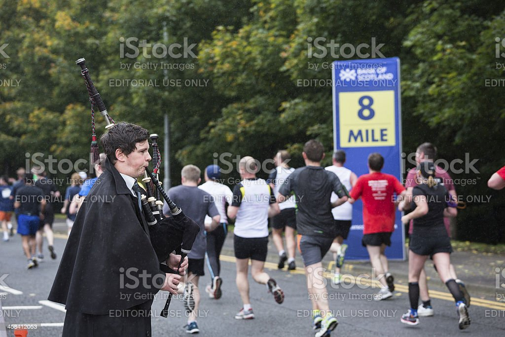 Great Scottish Run Bagpiper stock photo