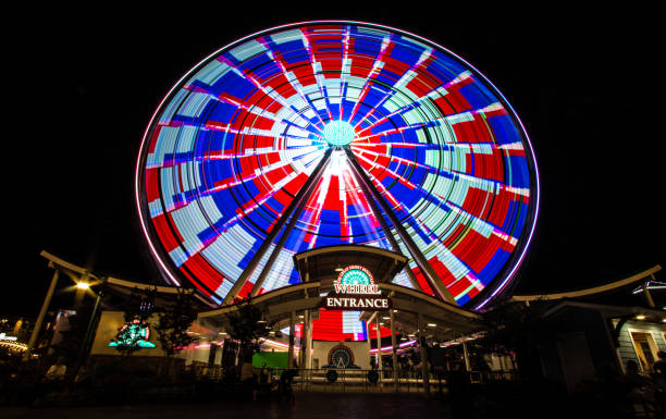 Great Smoky Mountain Sky Wheel In Pigeon Forge Tennessee Pigeon Forge, Tennessee, USA - May 15, 2017: The Great Smoky Mountain Sky Wheel located at the Island entertainment complex in the resort town of Pigeon Forge, Tennessee. pigeon forge stock pictures, royalty-free photos & images