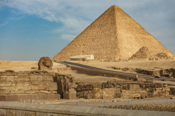 Great Sphinx of Giza in front of pyramids stock photo
