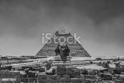 Great Sphinx of Giza, Cairo, Egypt, aligned with piramid. Black anda white, retro style.