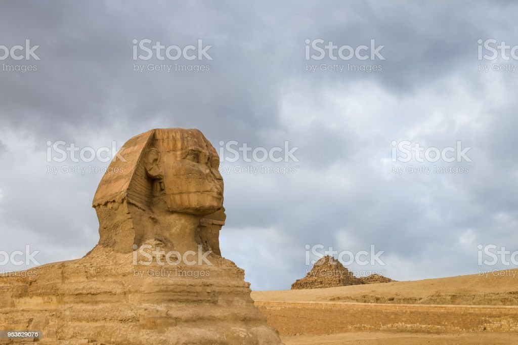 Great Sphinx profile wih pyramids on background in Giza, Egypt stock photo