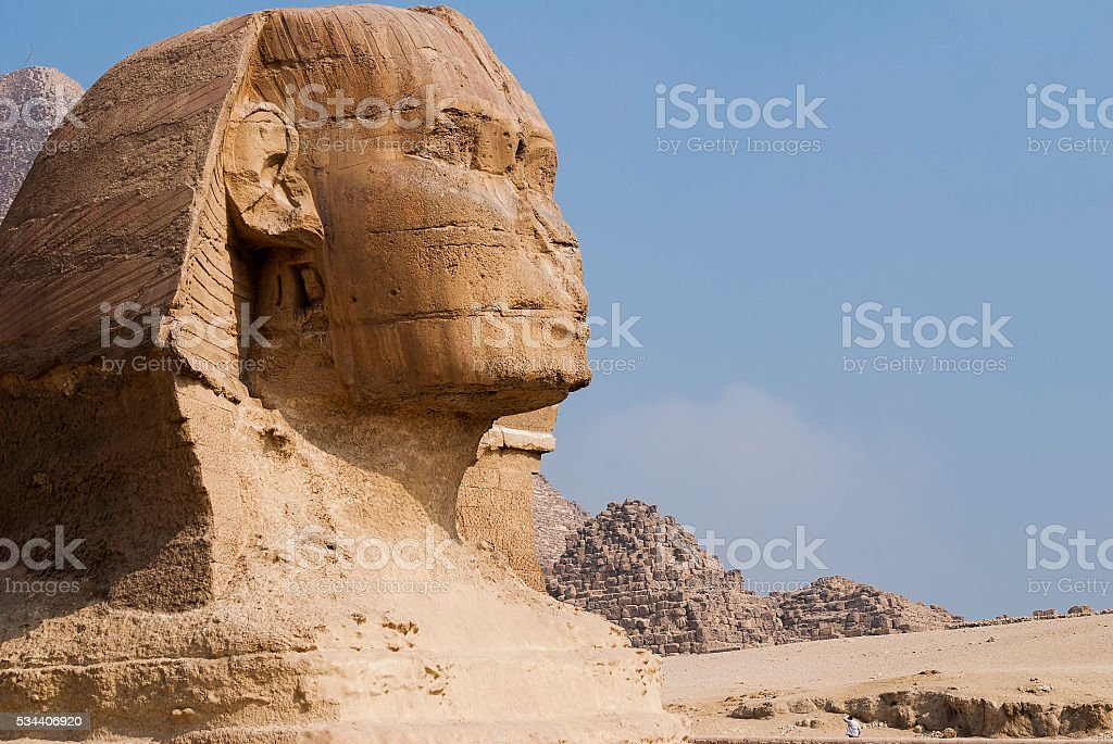 great sphinx with pyramid in the background in Giza, Egypt stock photo