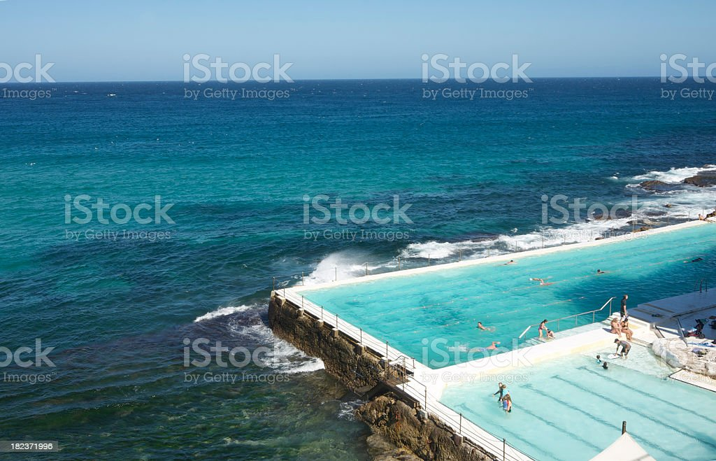Great swimming pool in Bondin Beach meeting the ocean stock photo