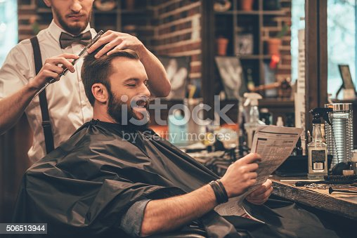 986804130istockphoto Great time at barbershop. 506513944