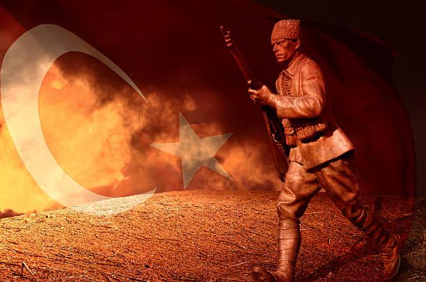 great turkish soldier and  flag - turkse etniciteit stockfoto's en -beelden