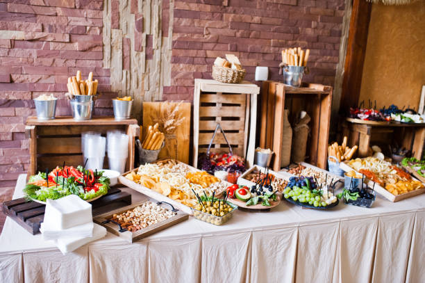 Great variety of different multicolored snacks on the wedding buffet. stock photo