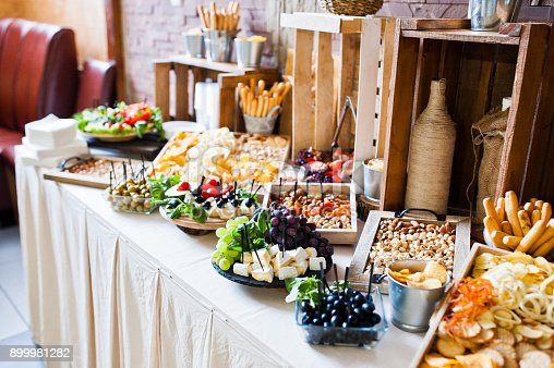 istock Great variety of different multicolored snacks on the wedding buffet. 899981282