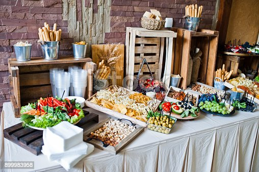 istock Great variety of different multicolored snacks on the wedding buffet. 899983958