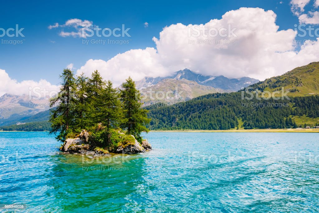 Great view on azure lake Silsersee (Sils) and peak Piz Corvatsch. stock photo