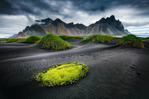 Great wind rippled beach black sand. Location famous place Stokksnes cape, Vestrahorn (Batman Mountain), Iceland, Europe.
