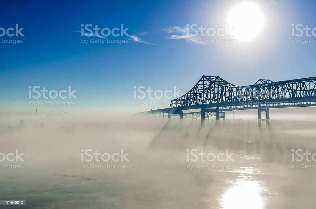 Greater New Orleans Bridge at sunrise, mist on the river stock photo