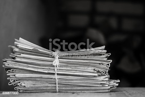 istock Greater pack of newspapers on a table 636877000