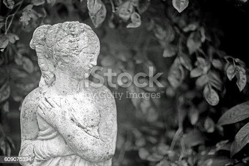 868668568 istock photo Grecian statue monochrome 609075394