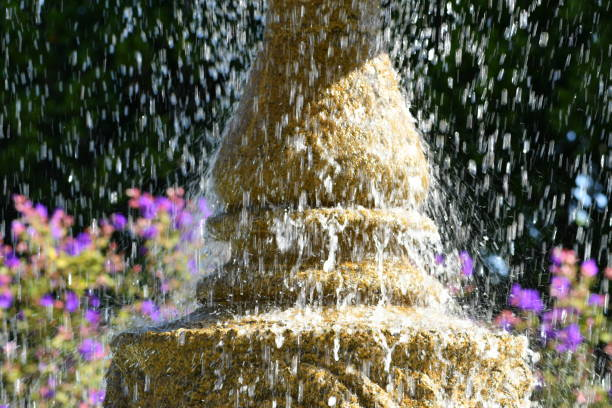 greco-roman fountain with flowers - steven harrie stock photos and pictures