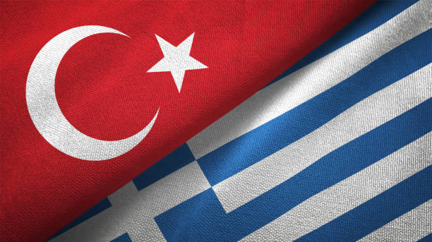 greece and turkey two flags together textile cloth fabric texture - grecia stato foto e immagini stock