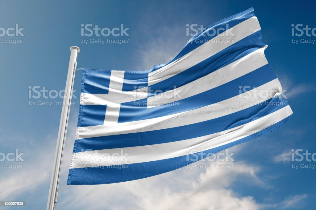 Greece Flag is Waving Against Blue Sky stock photo