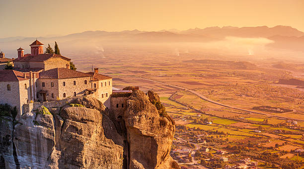 Greece Kalambaka monastery A look at the Kalambaka scenery, also called Kalabaka, where the Meteoras are in the Thessaly Plain in Greece. The monasteries were built on sandstone rock pillars. monastery stock pictures, royalty-free photos & images
