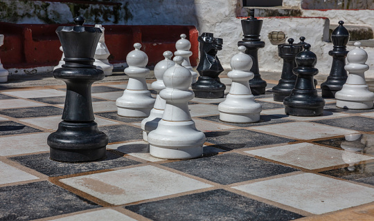 Greece, Kea island. Giant set of chess pieces on Ioulis town street