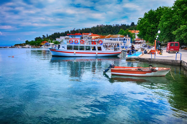 Greece, Thasos port with boats and promenade view stock photo