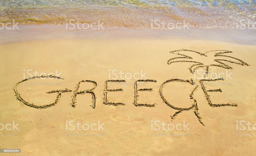 Greece written on sand - beach note icon foto stock royalty-free
