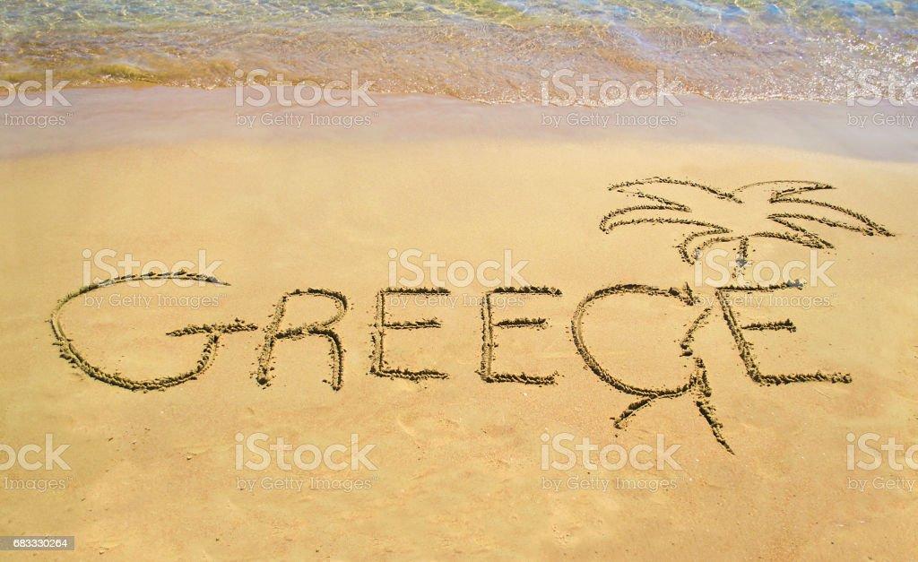 Greece written on sand - beach note icon royalty-free stock photo