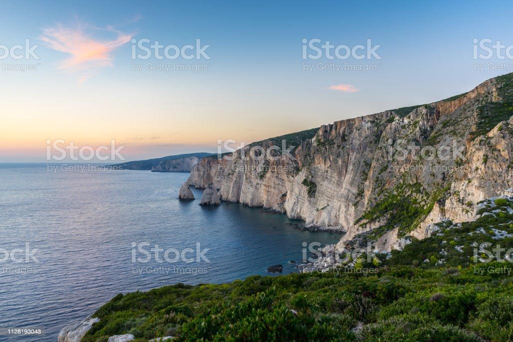 Greece, Zakynthos, Beautiful greek waterside coastline landscape after sunset