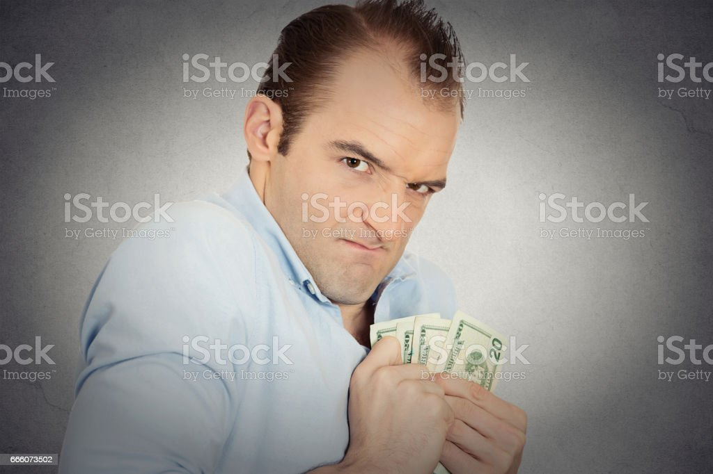 greedy banker executive CEO boss, corporate employee funny looking man holding dollar banknotes stock photo